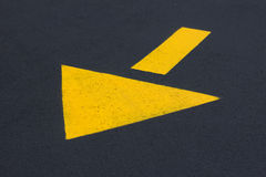 Yellow Traffic Arrow Stock Photo