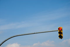 Yellow traffic light. With blue sky background Stock Photo