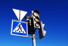 Yellow traffic light. And pedestrian crossing sign Stock Photo