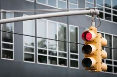 Yellow Traffic light with red sigh flashing Stock Image