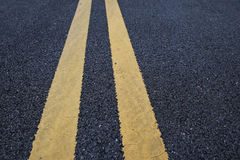 Yellow Traffic Lines Marking On Asphalt Road Royalty Free Stock Photography