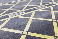 Yellow traffic sign on asphalt Stock Image