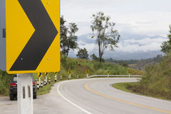 Yellow Traffic sign on curve road. Traffic sign on curve road showing curve road ahead royalty free stock image