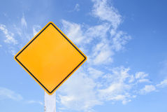 Yellow traffic sign isolated on blue sky Royalty Free Stock Photo