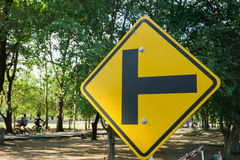 Yellow traffic sign of junction in public park Royalty Free Stock Images