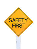 Yellow traffic sign text for safety first isolated Royalty Free Stock Photos