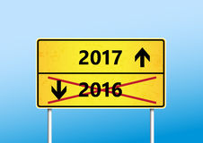Yellow traffic sign with upcoming 2017. And cross out 2016 year with arrows stock illustration