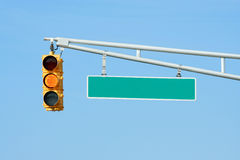Yellow traffic signal light with sign Stock Photo
