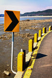 Yellow traffic signs on seaside border Stock Photos