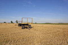 Yellow trailer in an agricultural landscape Royalty Free Stock Photography