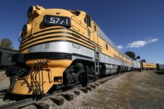Yellow Train. A beautiful yellow train stretches out along the railroad tracks Stock Images