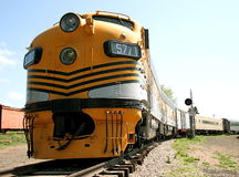 Yellow Train. A beautiful long yellow train stretches a long way down the track Royalty Free Stock Photography