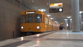 Yellow train in Berlin subway arriving the platform at Bundestag station