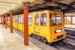 Yellow train coming on subway station, Budapest - Hungary Stock Image