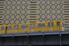 Yellow train on elevated railway Royalty Free Stock Photography
