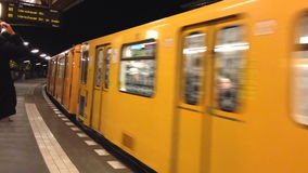 Yellow train enter the station in Berlin stock video footage