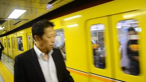 Yellow train Ginza line stopping receive passengers go to Tokyo at Ueno railway station. TOKYO, JAPAN - OCTOBER 20 : Yellow train Ginza line stopping receive stock video footage