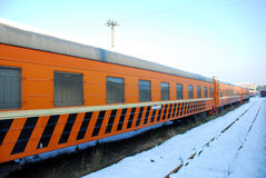 The yellow train on platform in winter. The yellow train on platform with snow in winter Royalty Free Stock Photos