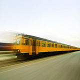 Yellow train in speed Stock Image