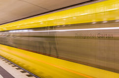 Yellow Train speeding. Away in the subway station of Zoologischer Garten in Berlin Stock Photography