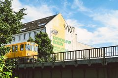 Yellow Train Beside Teppichland Berun Building Stock Images