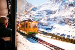 Yellow train of wengernalpbahn at Kleine Scheidegg station, Jung Stock Images