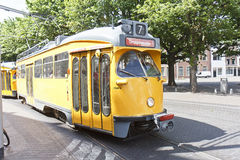 Yellow Tram. In front of the Dutch Parliament at The Hague, Netherlands stock image
