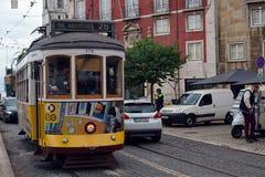 Yellow tram in Alfama. Lisboa. Portugal