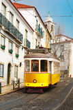 Yellow 28 tram in Alfama, Lisbon, Portugal Stock Photo