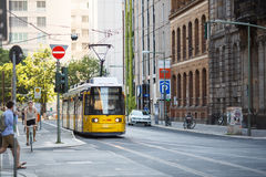 Yellow tram in Berlin Mitte, Germany. Tramway public transport. Berlin, Germany - June  26, 2016: Yellow tram in Berlin Mitte, Germany. Tramway public transport Stock Photos