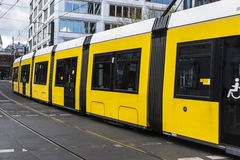 Yellow tram circulating in Berlin, Germany. Yellow tram circulating with a sign of handicapped in Berlin, Germany Stock Photo
