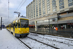 Yellow tram in city street Stock Photo