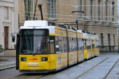 Yellow tram in city street Stock Image
