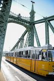 Budapest, Hungagry - september, 12, 2018 - Yellow Tram crosses liberty bridge royalty free stock photography