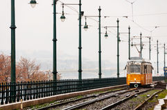 Yellow Tram in early winter with cloudy sky in Budapest Royalty Free Stock Photos