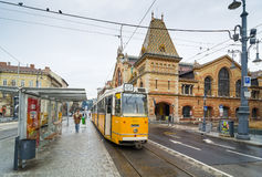 Yellow tram and Great Market Hall in Budapest, Hungary. Stock Image
