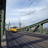 A yellow tram on green bridge Royalty Free Stock Photos