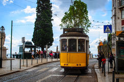 Yellow tram in lisbon, portugal. Tram number 28 in lisbon going down the hill Royalty Free Stock Photos