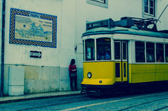 Yellow tram in lisbon, portugal. Tram number 28 in lisbon going down the hill Royalty Free Stock Photography