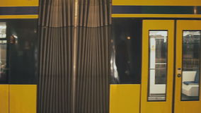 Yellow tram rides through the streets of Prague.  stock video footage