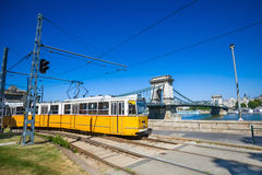 Yellow tram on the river bank of Danube in Budapest Stock Photo