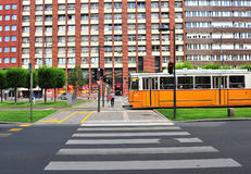 Yellow tram in the street of Budapest downtown Stock Photo