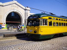 Yellow Tram and three wheeled bike at Pier 15 in San Francisco, Stock Photos