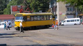 Yellow tram. Turns to a halt stock footage