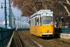 Yellow tram. Typical European Yellow Tram on edge of Danube Budapest Royalty Free Stock Photo