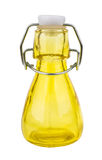 Yellow transparent bottle with bung for vegetable oil on white. Yellow transparent bottle with bung for vegetable oil isolated on white background Royalty Free Stock Images