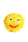 Yellow Transparent Pills In The Shape Of Face Stock Photography