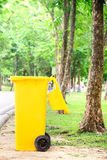 Yellow trash bin Royalty Free Stock Photography