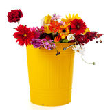 Yellow trash can flowers royalty free stock image