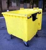 Yellow trash can Royalty Free Stock Photos